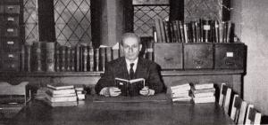Philip Khuri Hitti sitting at his desk at Princeton University, 1949